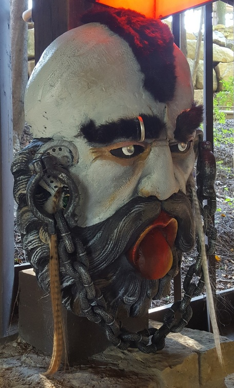 One of the many great masks decorating the path when you leave the House and enter what looks like a small mill. I thought,