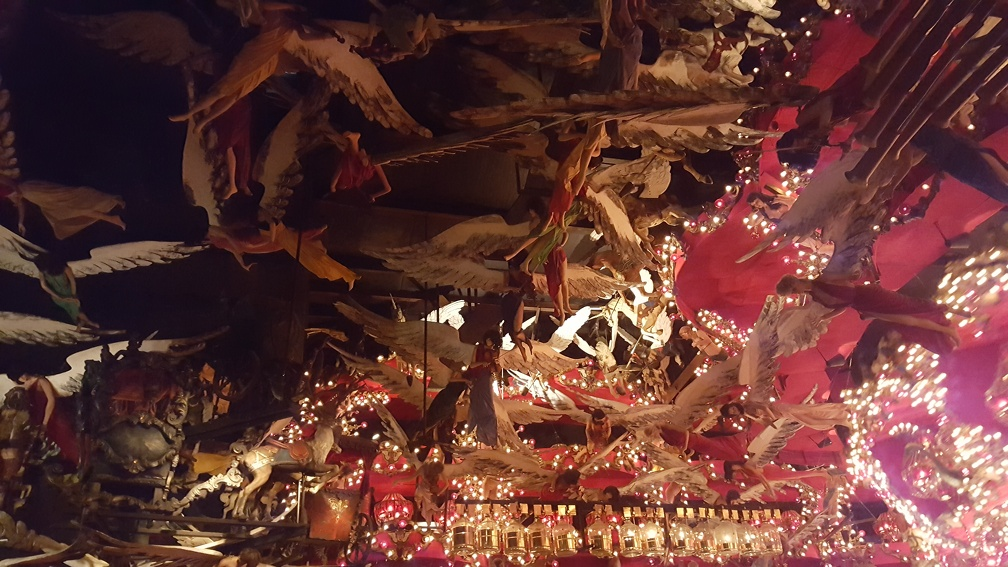 The carousel room is insane, a ceiling covered in angels, walls of horses, a couple carousel like sculptures spinning nearby, etc.