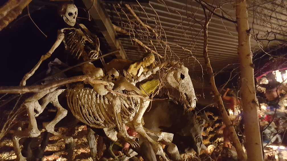 Roof of a secondary room full of carousel sculptures contains skeletal horsemen. Important life lesson: look up!